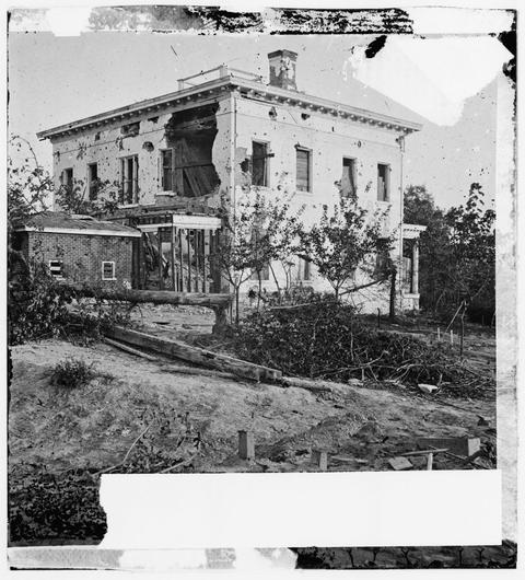 The shell-damaged Ponder House in Atlanta